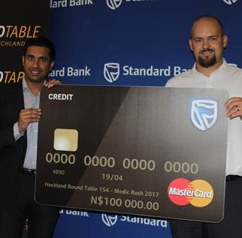 SPONSORSHIP TO MEDIC RUSH – Standard Bank contributed N$100 000 to the Medic Rush Project to promote health care delivery in disadvantaged communities in the country. Standard Bank's Acting Chief Executive Amit Mohan hands over the donation to Hochland RoundTable's Chairman Basson van Rooyen.